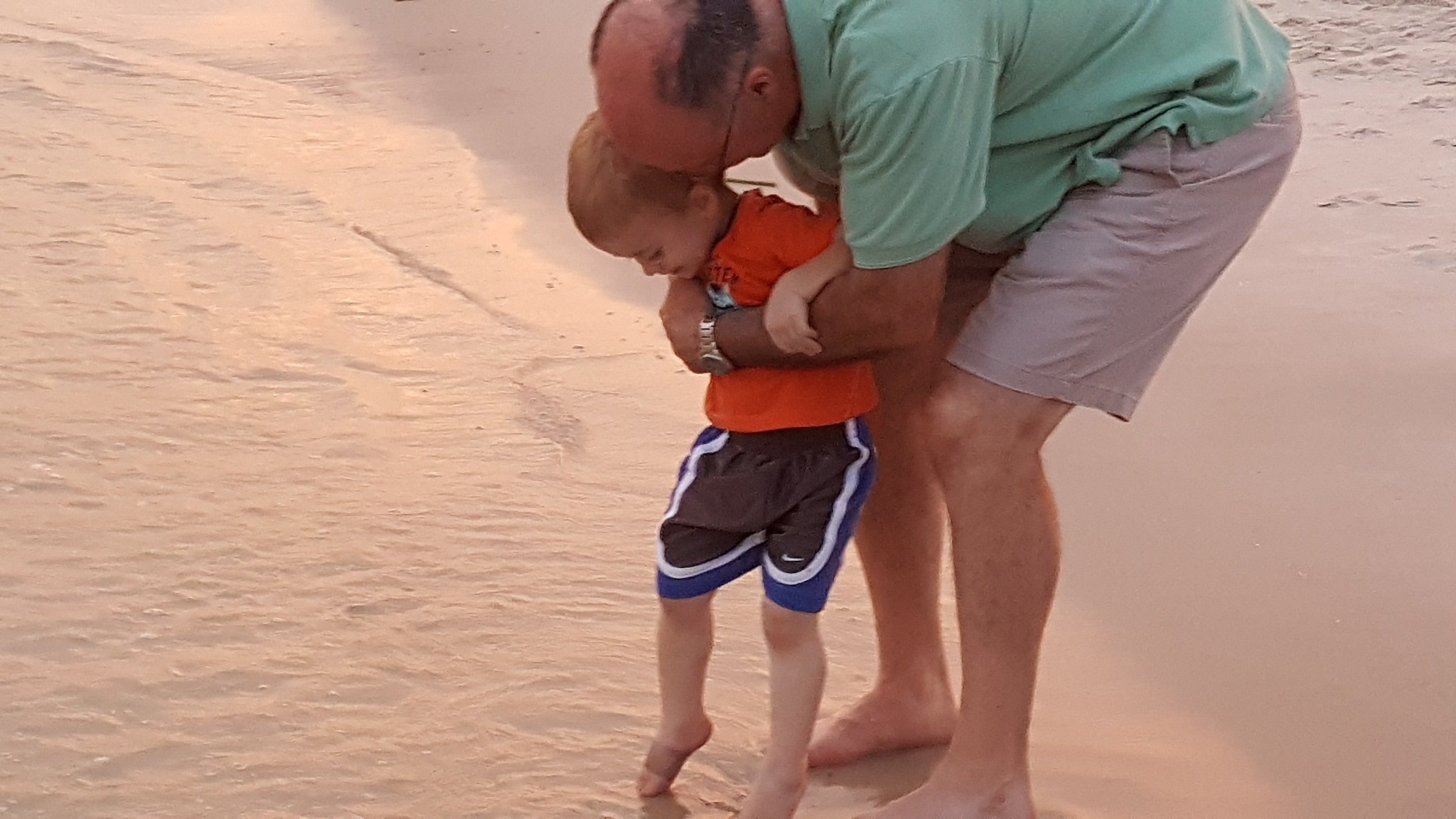 alavhr grandpa with boy at beach